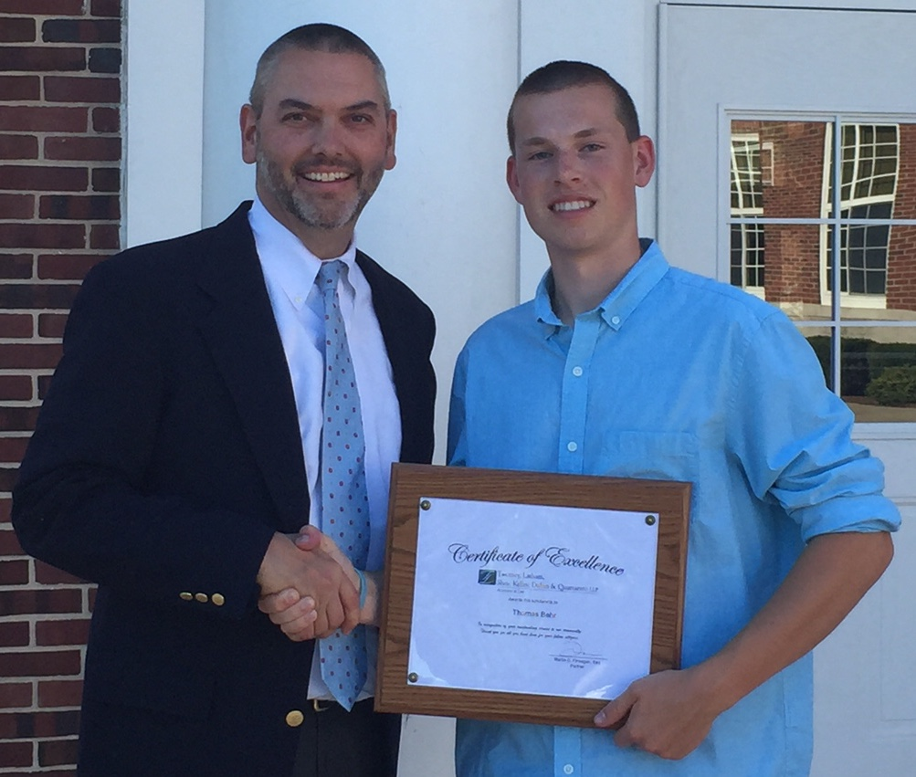Mattituck junior senior high school scholarship recipient and Partner Martin Finnegan