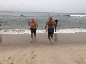 Twomey Latham legal team leaving the water at polar plunge