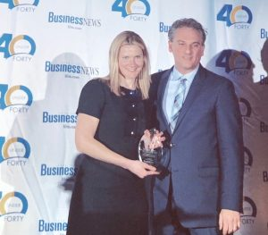 katarina Grinko accepting 40 under 40 award LIBN awards