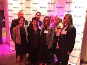group photo Lisa Clare Kombrink and several women accepting Top 50 women LIBN award